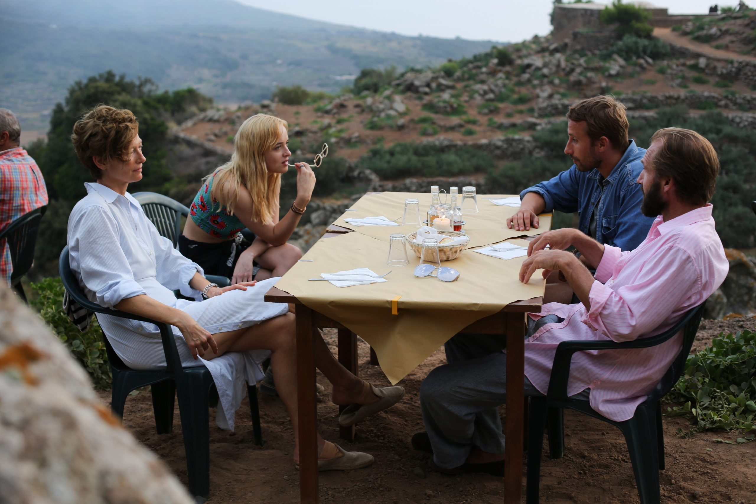 Swinton, Dakota Johnson, Matthias Schoenarts and Fiennes dine on Pantelleria in A Bigger Splash