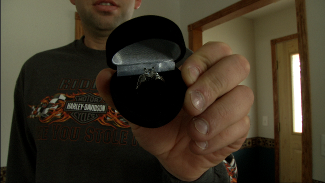 A participant of the love tour brandishes the symbol of his hopes: a ring
