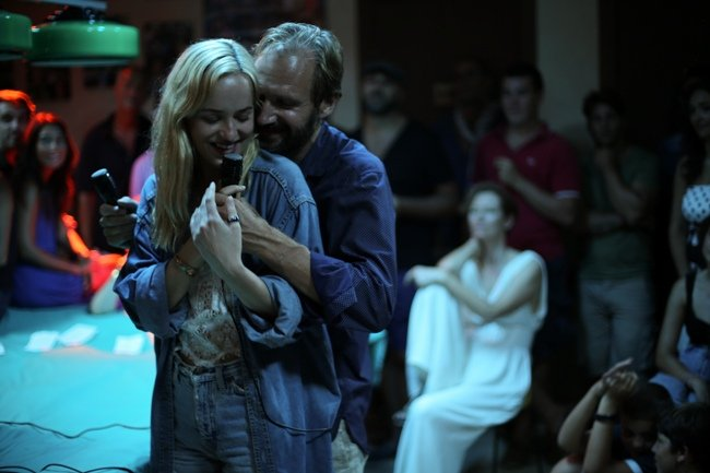 Ralph Fiennes, with Dakota Johnson, in A Bigger Splash