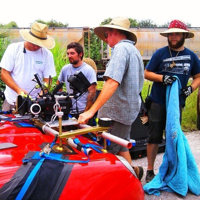"The grips and electrics of ""Two Days"" rig the camera to a Thunderbird."