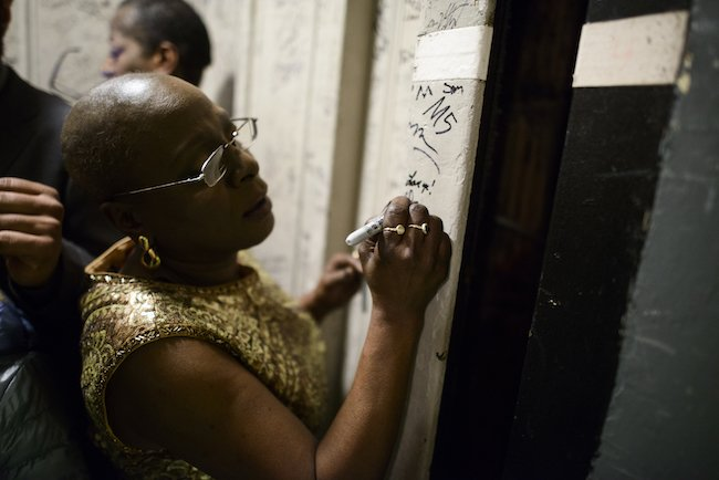 """NEW YORK, NY - February 6th, 2014 - """"Love ya!"""" Sharon adds a note and her autograph to the Beacon Theater elevator after her triumphant show."""
