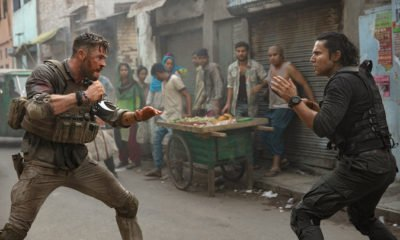 "Chris Hemsworth and Randeep Hooda in the 12-minute ""oner"" in Extraction, directed by Sam Hargrave Keanu Reeves Charlize Theron"