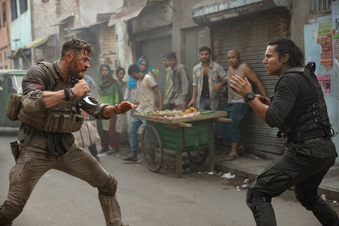 "Chris Hemsworth and Randeep Hooda in the 12-minute ""oner"" in Extraction, directed by Sam Hargrave"