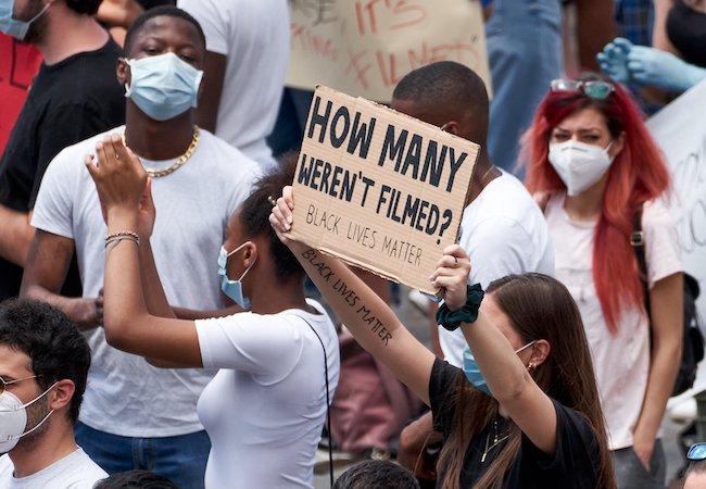 Black Lives Matter sign How Many Weren't Filmed Derek Chauvin George Floyd