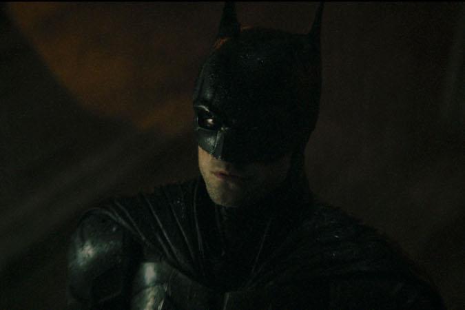 Robert Pattinson as Batman in The Batman, directed by Matt Reeves, courtesy of Warner Bros.