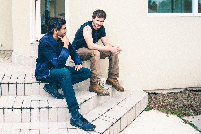 Director Ramin Bahrani and actor Andrew Garfield discussing a scene on the set of the film, 99 HOMES, a Broad Green Pictures release.