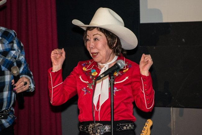 Documentary subject and Japanese country music singer Tomi Fujiyama receives a White Hat following the screening of MADE IN JAPAN at the 2015 Calgary International Film Festival. Photo credit: James Rooke