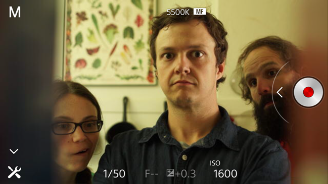 Director of photography, Molly Becker, director Mark Potts, and Spaghettiman himself, Benjamin Crutcher, test the framing of a shot where the camera is hidden in a cabinet. This is a phone screenshot, achieved through the Sony a7s' ability to stream to a phone app as an external monitor.