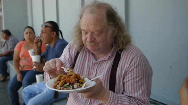 "Jonathan Gold eating a special ""Poseidon"" tostada from taco truck Mariscos Jalisco"