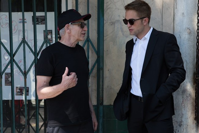 Cronenberg on set with Robert Pattinson, who plays Bruce Wagner-esque limosine driver Jerome