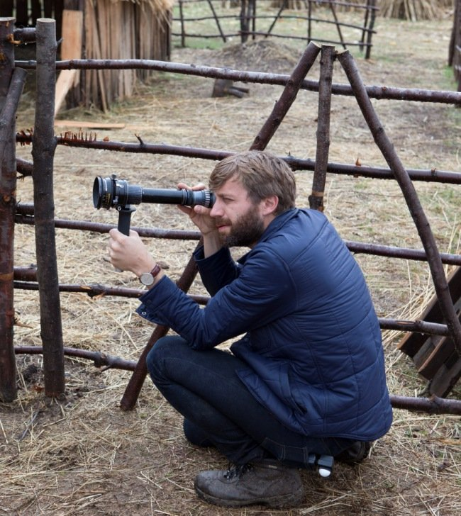 DP Jarin Blaschke holds a viewfinder up to The Witch's entirely purpose-built set