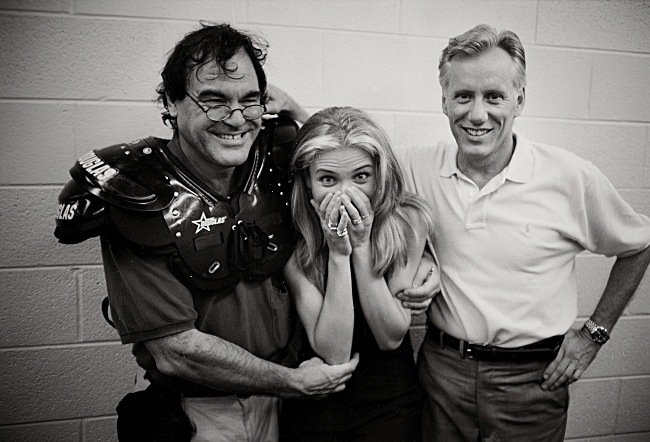 Oliver Stone, Cameron Diaz and James Woods in the Miami Sharks locker room, during the making of Any Given Sunday (1999). Courtesy of Abrams