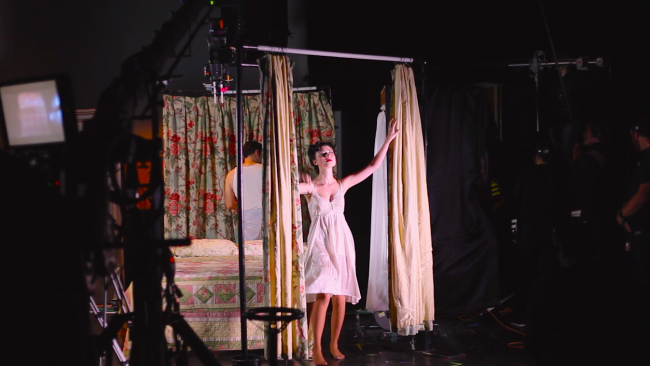 Actress Chandler Ryan performs a scene from Distant Vision for both the cameras and a live audience.