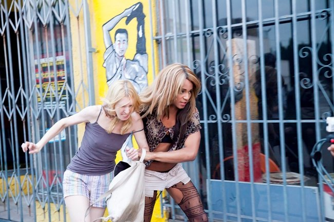 """Revenge-thirsty Sin-dee (Rodriguez) drags the """"fish"""" Dinah (O'Hagan) through the streets of West Hollywood"""