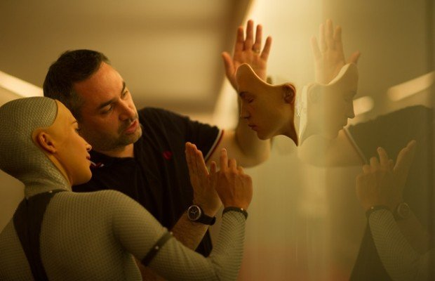 Alicia Vikander (Ava) and Alex Garland consult on the set of Ex Machina