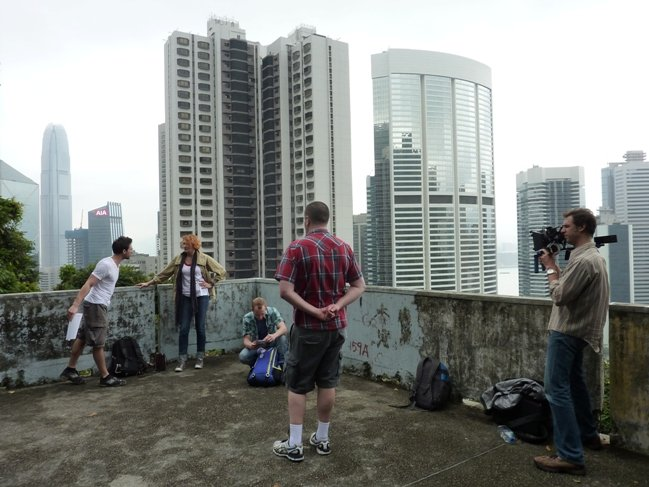 Balderson (center) shooting with crew in Hong Kong