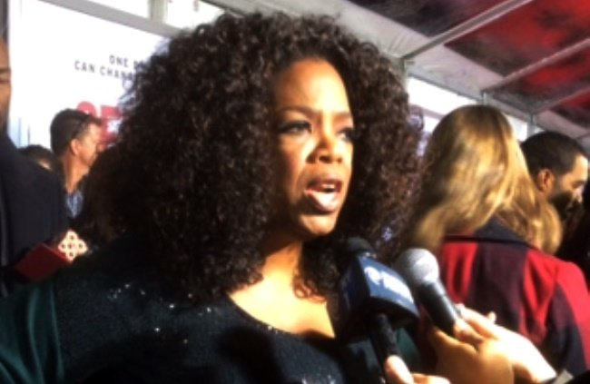 Winfrey answers questions at the Selma New York press conference
