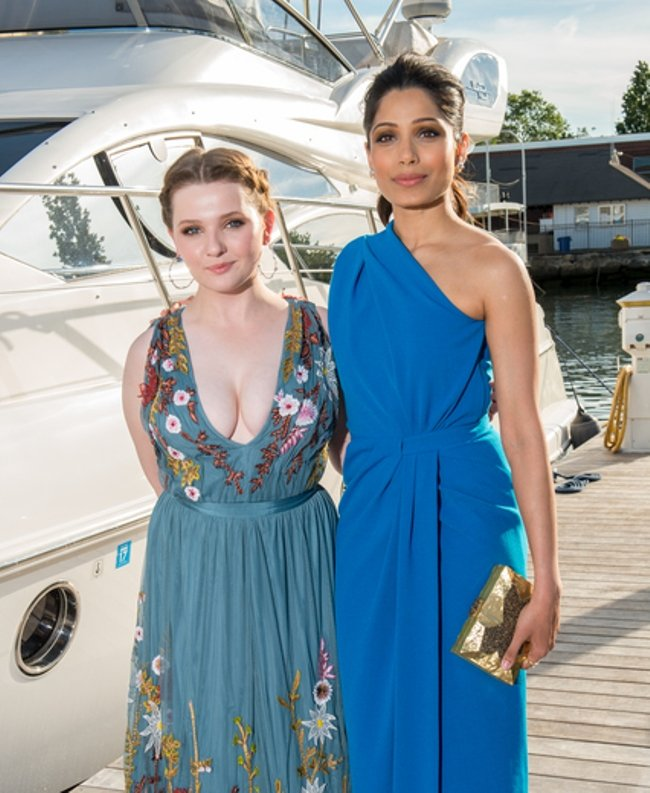 Abigail Breslin and Freida Pinto at the Greenwich International Film Festival. Courtesy of Getty Images