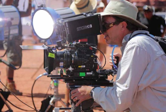 Hurlbut using a SmallHD on-board monitor on set.