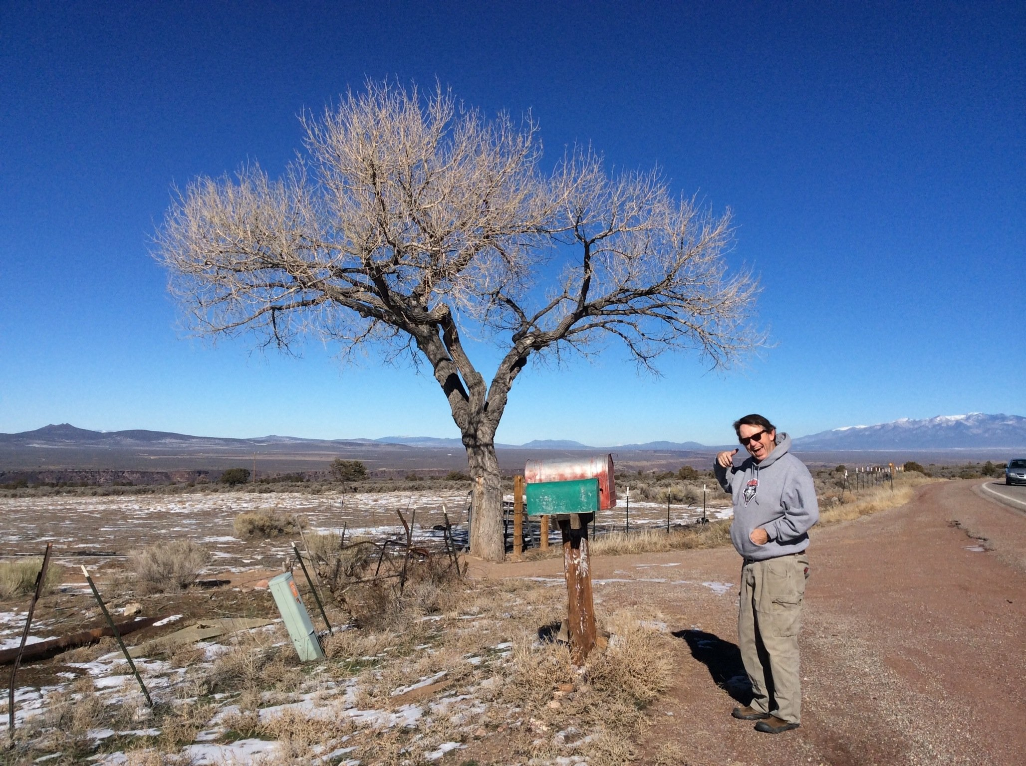 Jackson on a plot of land he has for sale in Taos