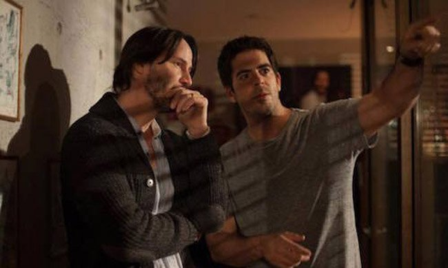 Director Eli Roth on-set of Knock Knock with actor, Keanu Reeves.