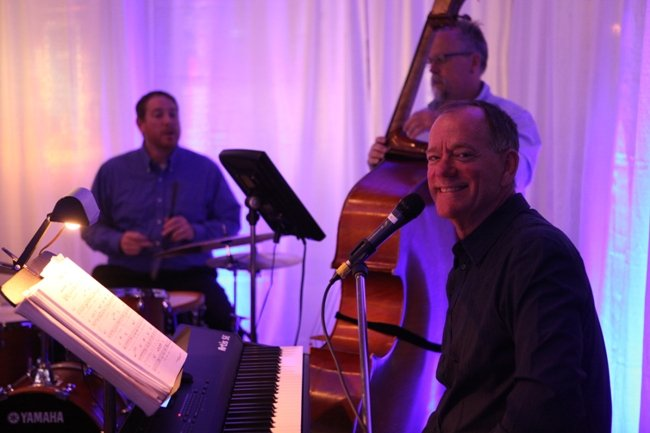 The Denny Hess Trio performs at the world premiere party of Live Another Day at Myrtle Beach