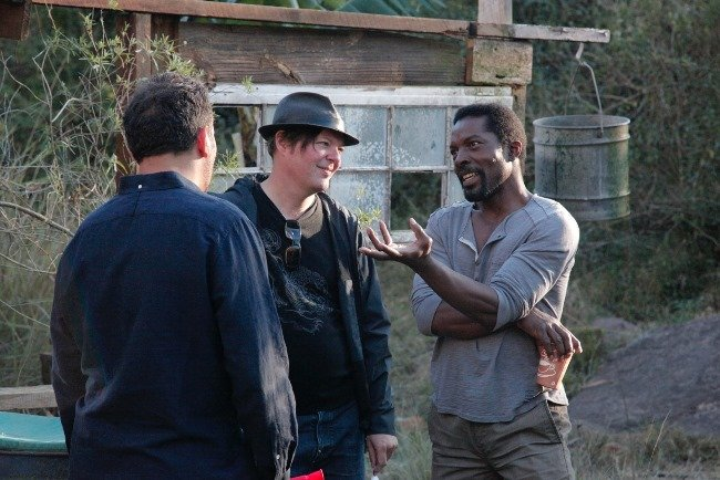 Isaach De Bankolé (far right) chats with crew on set