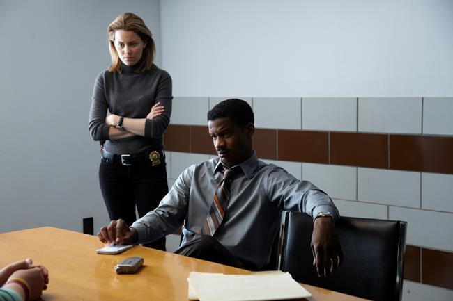Elizabeth Banks and Nate Parker as the detectives who suspect Fuller and Manning of homicide