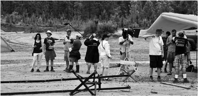 Zala's crew on the set of Raiders: The Adaptation, followed by crew from the documentary