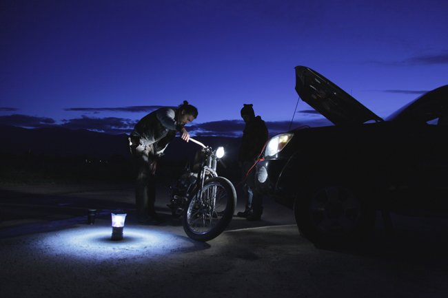 Momoa fixes his bike one early morning in Bishop, CA, while shooting Paloma. Photograph by Brian Andrew Mendoza