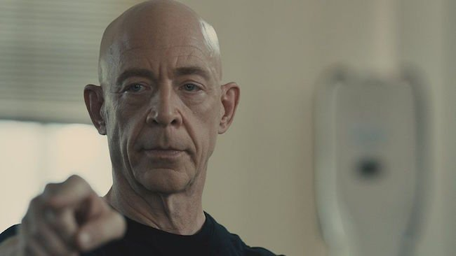 """Chazelle chose drab white walls for the studio in the short """"Whiplash,"""" instead of the impassioned reds in the feature"""