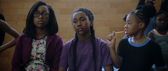 Lauren Gibson as Maia (left), Royalty Hightower as Ton i (center), and Alexis Neblett as Beezy (right) in Anna Rose Holmer's THE FITS