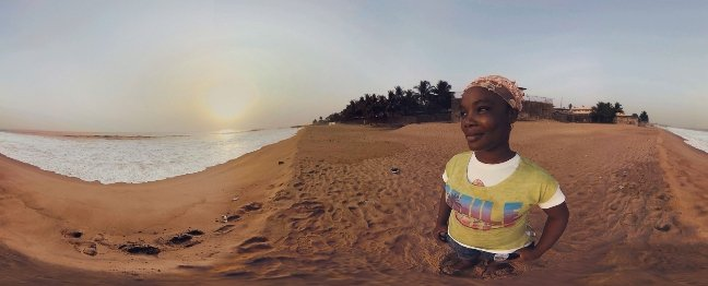 "Ebola survivor Decontee Davis on the shores of Liberia in VR project ""Waves of Grace,"" a Vrse production by Chris Milk, Gabo Arora and the United Nations. Courtesy of Within"