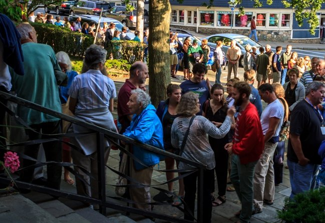 The rush line: Crowds descend upon the Woods Hole Film Festival in Cape Cod. Photograph by E. Gene Chambers