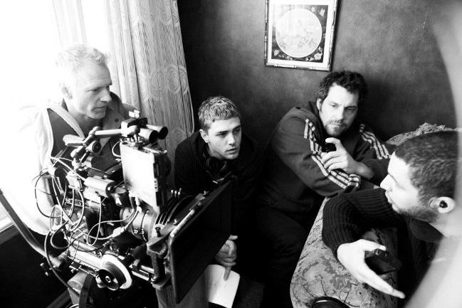Xavier Dolan on the set of Mommy with cinematographer André Turpin, focus puller and 1st assistant director. Photograph by Shayne Laverdière