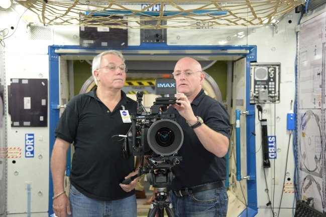 Neihouse and NASA astronaut Scott Kelly during an IMAX® camera training session at the Space Station Mockup and Training Facility (SSMTF) at NASA's Johnson Space Center, Houston Texas