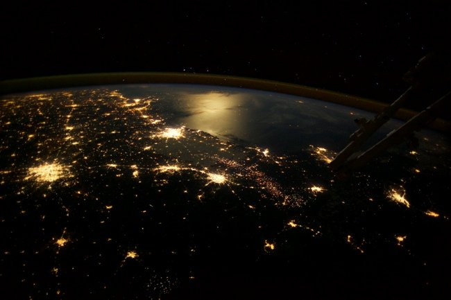 Dallas, Houston, San Antonio and the Gulf of Mexico are seen in this spectacular view over Texas. Gas and oil well flares are visible
