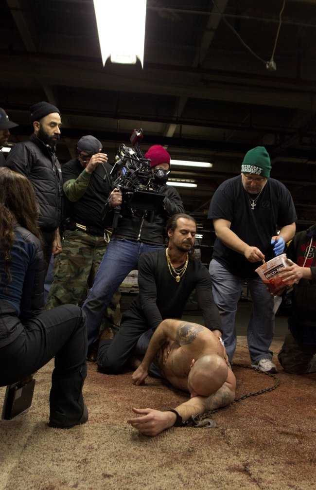Getting the neck stabbing shot ready -- Director Malik Bader, DP Christos Moisides and SFX Dan Phillips with actors Paskoski and Shreli. Photograph by Tom Meredith