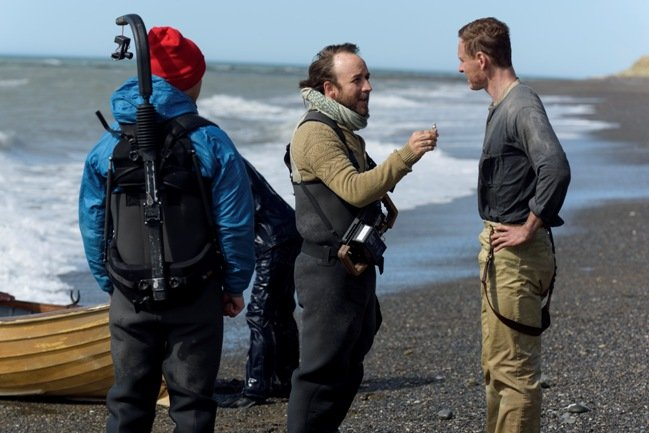 Derek Cianfrance (center) talks to Fassbender (right) on set