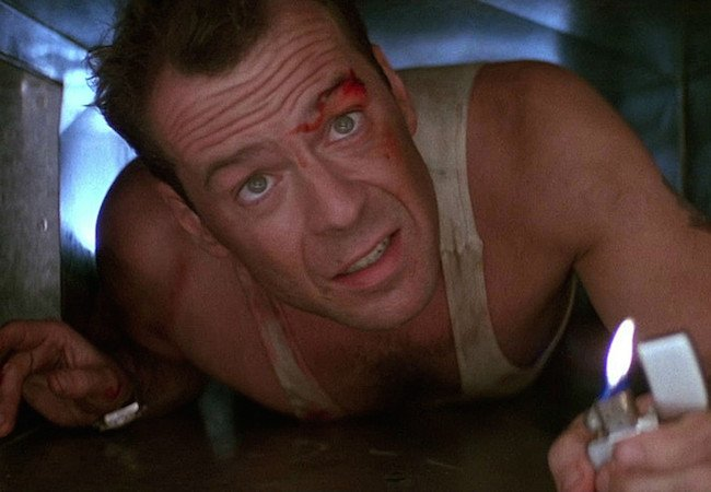 Bruce Willis as John McClane in Die Hard. Image Courtesy of Twentieth Century Fox.