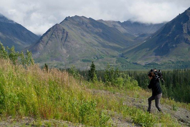 DP hillary Spera hauls the 35mm camera up a mountain to get a great vista shot during a frequent travel rest stop on the road.