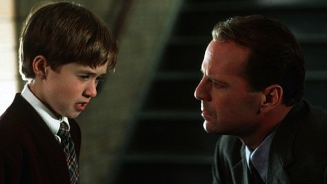 Haley Joel Osment as Cole Sear and Bruce Willis as Dr. Malcolm Crowe in The Sixth Sense