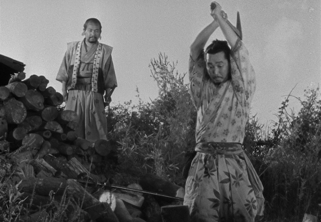 Minoru Chiaki as Heihachi chopping wood in Seven Samurai