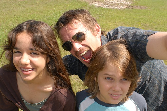 Samantha (Lorelei Linklater), Mason Sr. (Ethan Hawke), and Mason (Ellar Coltrane), age 9, in Richard Linklater's BoyhoodI/i>. Courtesy of Matt Lankes. An IFC Films Release.