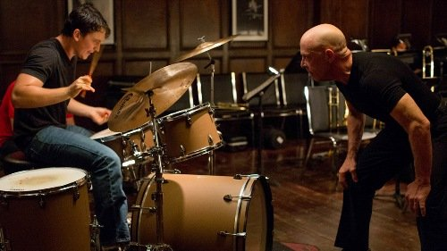 Miles Teller and Paul Reiser in Whiplash. Courtesy of MovieStillsDB.com